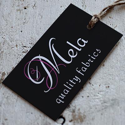 Mela Fabrics Logo Design